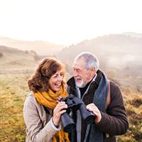 Man and Woman Looking Through Binoculars