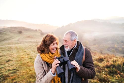 Older Man and Woman Looking Through Binoculars