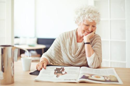 Senior woman reading magazine