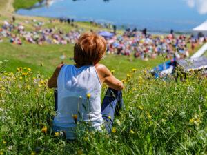 Boy sitting on a hill