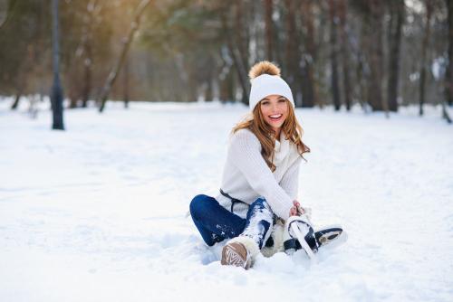 Woman Sitting in Snow
